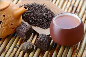 chinese-black-pu-erh-tea-and-tea-leaves-300x200.jpg