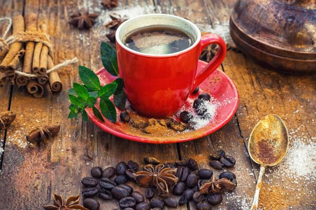 2018Food___Drinks_Red_coffee_cup_on_a_table_with_grains_and_bean_and_cinnamon_126259_.jpg
