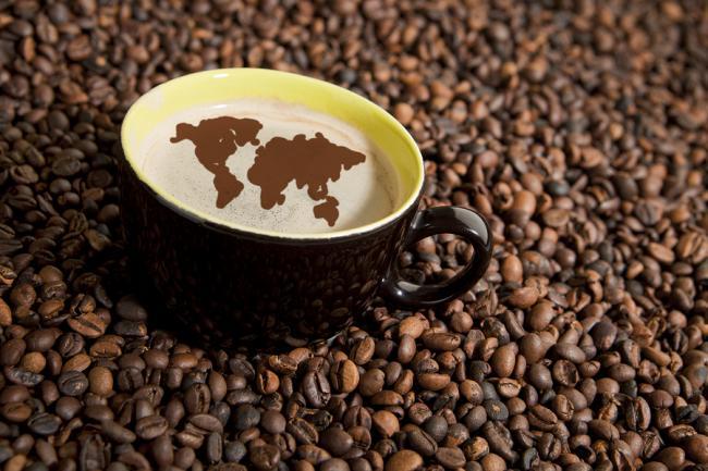bigstock-Coffee-Cup-In-Coffee-Beans-18083549.jpg