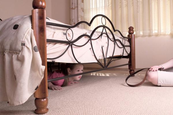 depositphotos_9605855-stock-photo-the-child-hides-under-a.jpg